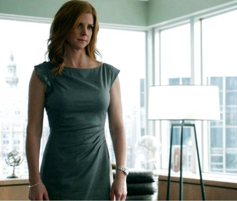 Donna Paulsen works a gray Hugo Boss dress (image via USA Network)
